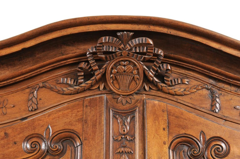 French 1740s Louis XV Walnut Armoire from Nice, with Hand Carved Foliage Décor For Sale 2