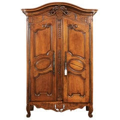 French 1740s Louis XV Walnut Armoire from Nice, with Hand Carved Foliage Décor