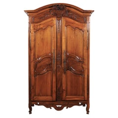 French 1770s Louis XV Cherry Armoire from Provence with Basket and Kissing Doves