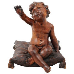 French 1780s Baroque Style Walnut Sculpture of a Putto Sitting on a Pillow