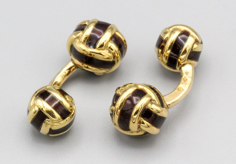 Classic and elegant 18K yellow  gold and dark brown enamel cufflink stud set of French origin. They resemble knots, with one side slightly larger than the other on the cufflinks. Includes four studs.  Hallmarks: French 18K gold assay mark, maker's