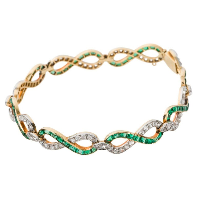 A beautifully crafted French bracelet that showcases 104 rose cut diamonds and 72 bright green emeralds. The infinity style link - 8 in all are fashioned from 18k yellow gold set with these magnificent gemstones, this bracelet is a work of art. The