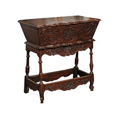French 1800s Walnut Dough Bin with Foliage Carved Motifs and Turned Legs