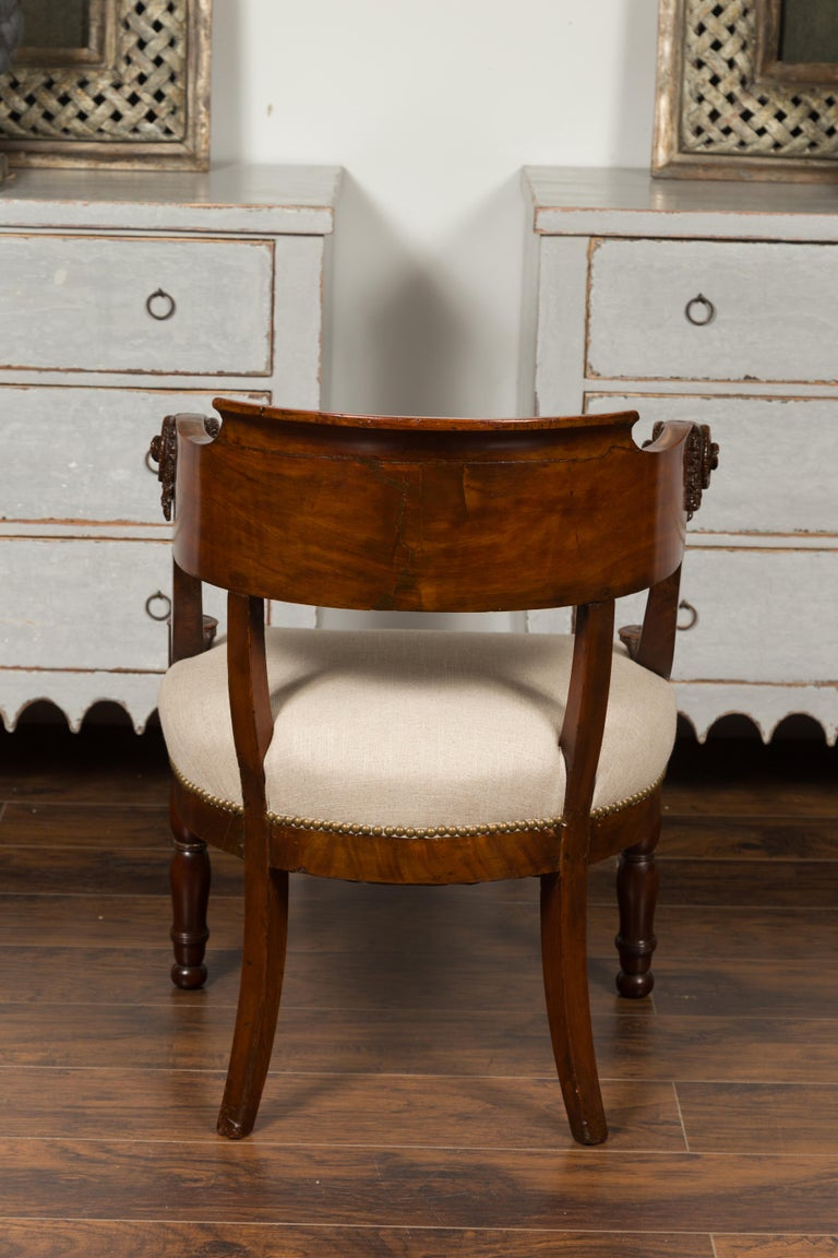 French 1830s Restauration Period Mahogany Armchair with Carved Rams' Heads For Sale 1