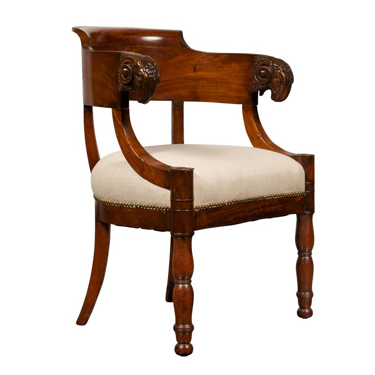 French 1830s Restauration Period Mahogany Armchair with Carved Rams' Heads For Sale