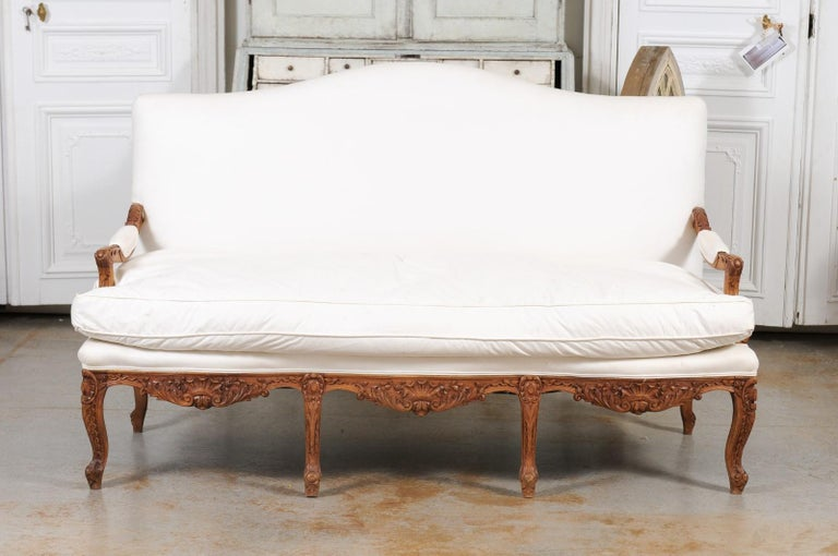 French 1850s Régence Style Three-Seat Canapé with Carved Shells and Upholstery In Good Condition For Sale In Atlanta, GA