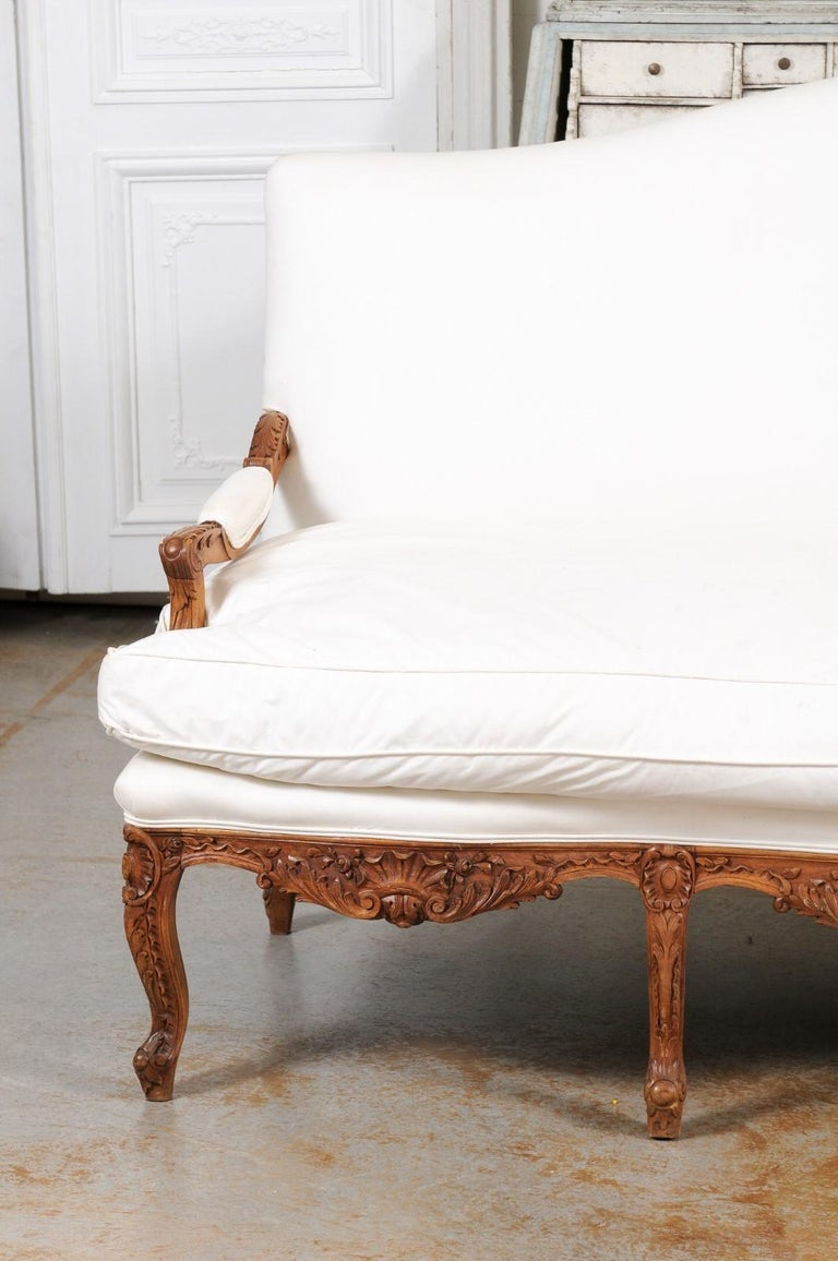 19th Century French 1850s Régence Style Three-Seat Canapé with Carved Shells and Upholstery For Sale