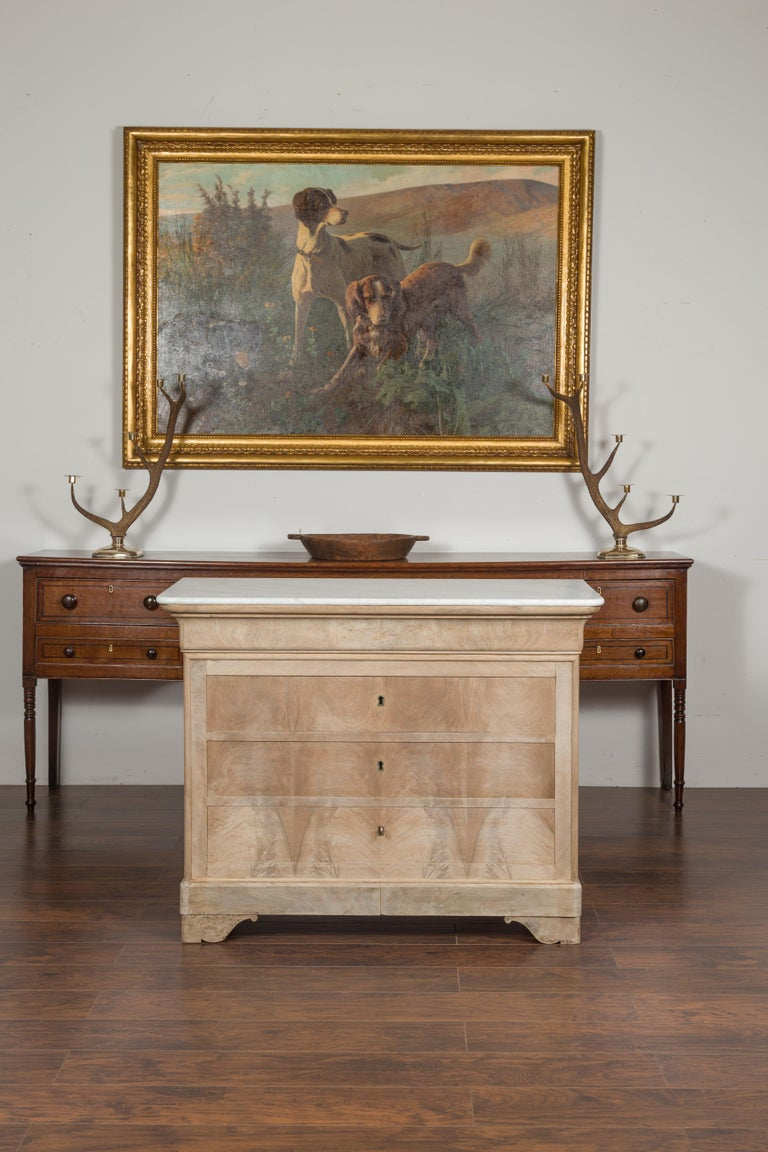 A French Louis-Philippe style bleached wood commode from the late 19th century, with new white marble top and four drawers. Born in France during the third quarter of the 19th century, this Louis-Philippe style commode features a rectangular white