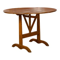 French 1880s Oak Wine Tasting Table with Round Tilt-Top and Trestle Base