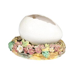 French 1890s Barbotine Majolica Egg Depicting a Cracked Shell on a Floral Nest