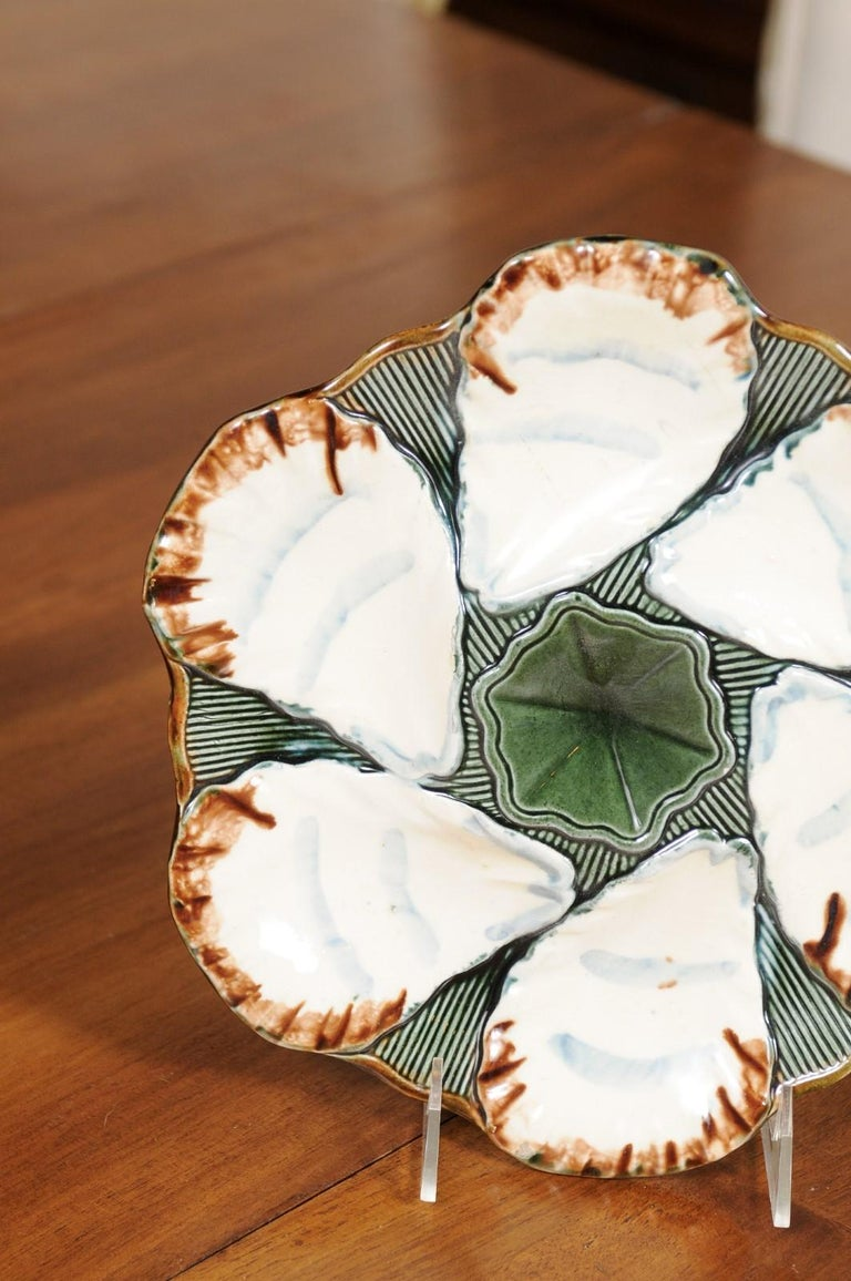 19th Century French 1890s Glazed Majolica Longchamp Terre de Fer Oyster Plate with Flower For Sale