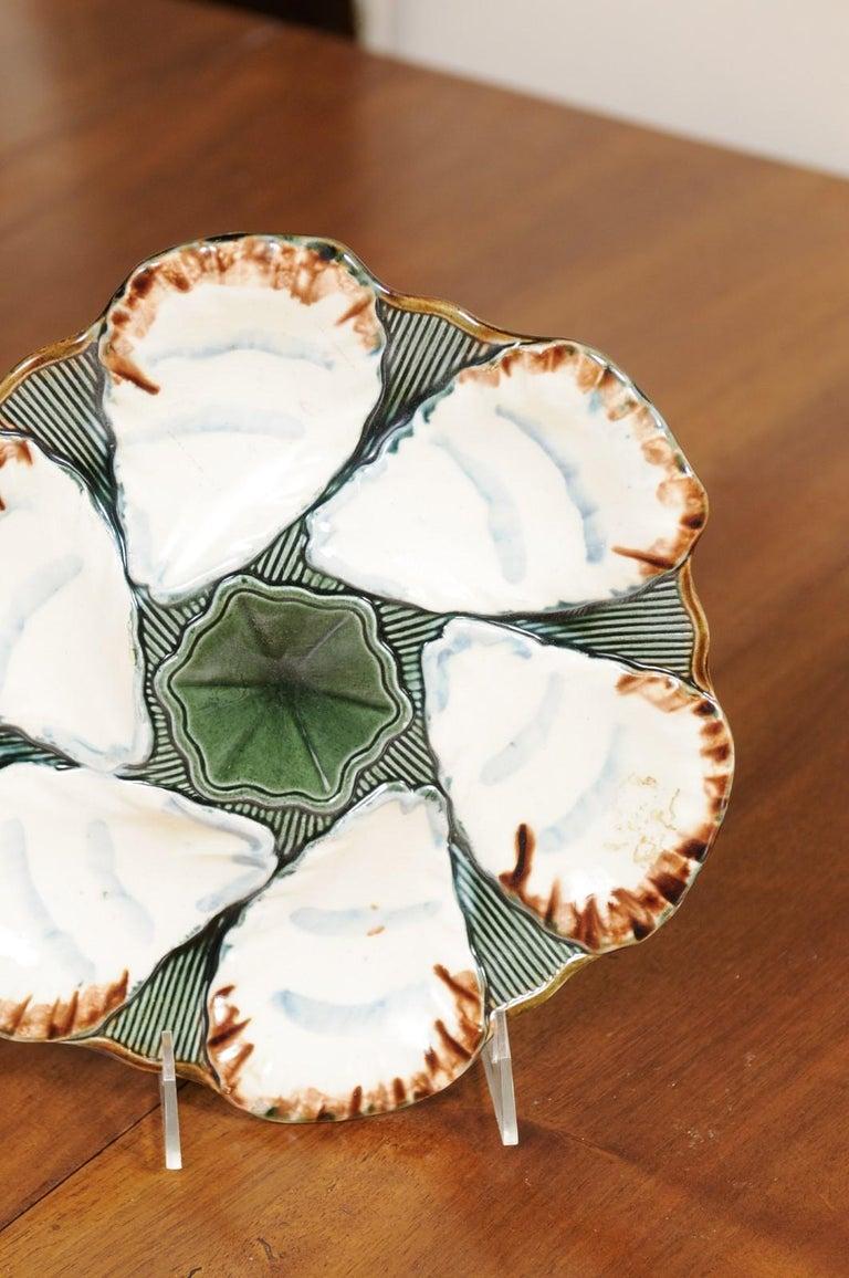 French 1890s Glazed Majolica Longchamp Terre de Fer Oyster Plate with Flower For Sale 1