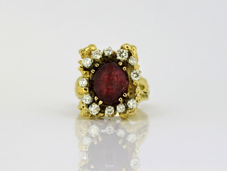 French 18k gold ladies ring with natural cabochon ruby and diamonds.  Made in France Circa 1940's  Hallmarked with an owl which has