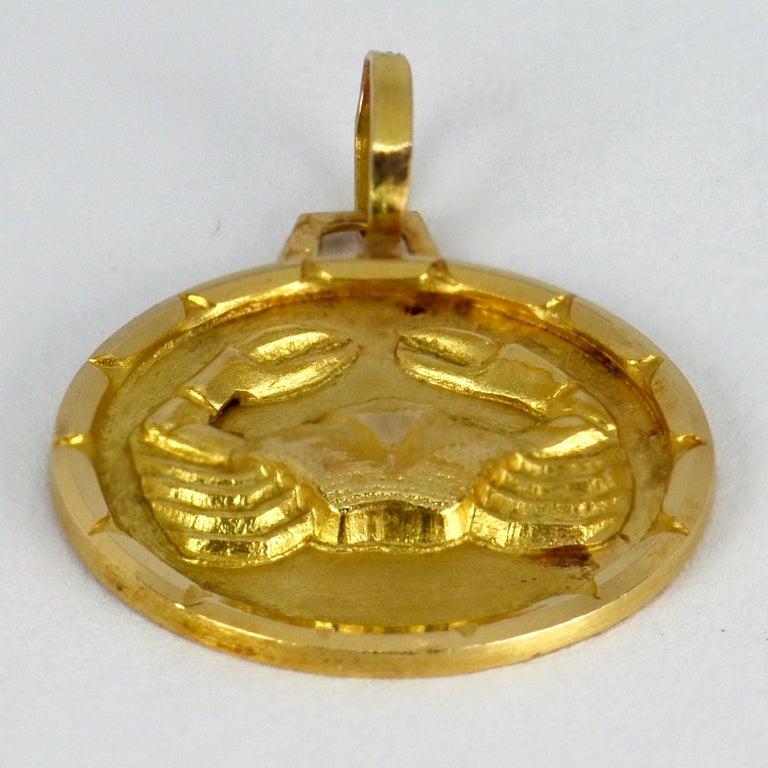 A French 18 karat (18K) yellow gold charm pendant designed as the zodiac star sign of Cancer, depicting a crab. Stamped with the French eagle's head for 18 karat gold.  Dimensions: 2.2 x 1.9 x 0.2 cm (not including jump ring) Weight: 2.20 grams