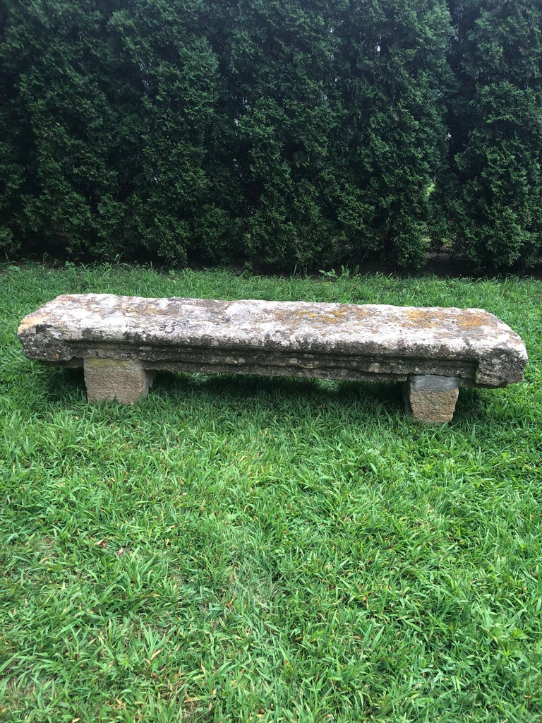 This rustic beauty is a rare piece indeed. Made of a local stone quarried near the Provencal town of Baux, it is known as Baux stone and is a creamy pale peach color underneath its heavily lichened and mossy surface. There is a shallow, but