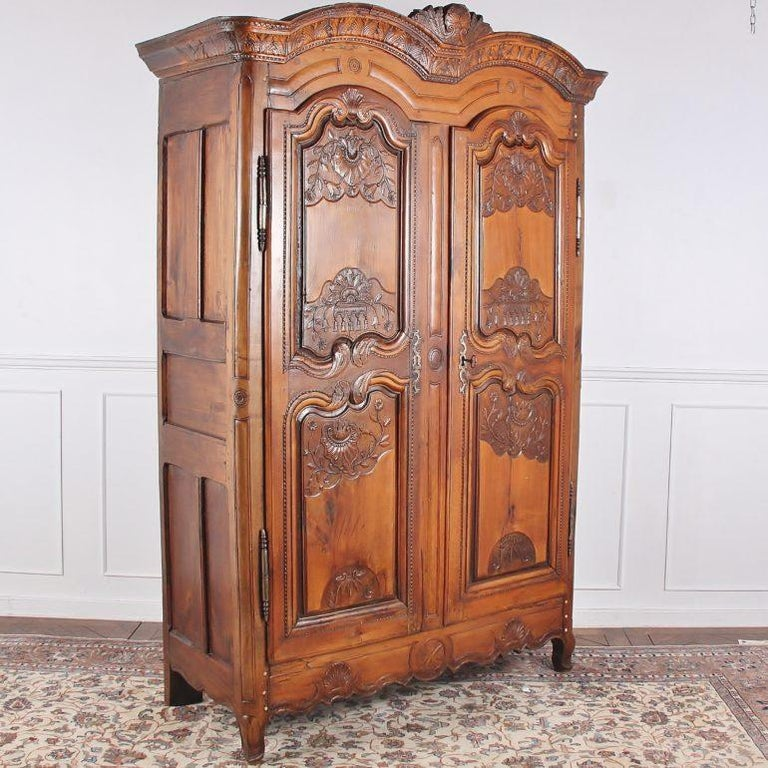 Carved French 18th Century Armoire For Sale