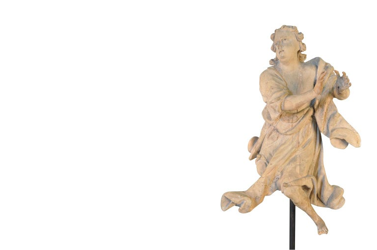 A very beautiful French 18th century statue of an angel - presented on its iron stand. Wonderfully hand-carved with stunning detail. The statue itself measures 34 3/4