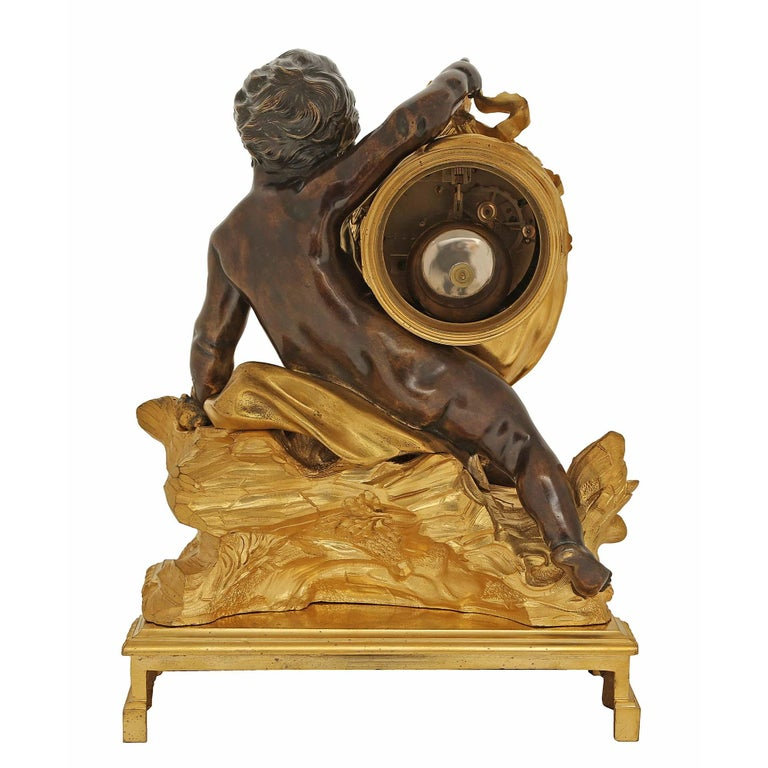 18th Century and Earlier French 18th Century Louis XV Period/Louis XVI Ormolu and Patinated Bronze Clock For Sale