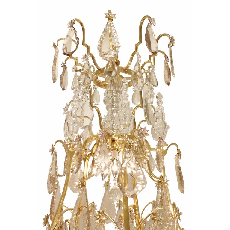 A sensational and extremely high-quality French 18th century Louis XV period ormolu and crystal chandelier. The chandelier is centered by a charming and finely cut hand-blown crystal ball below a tier of cut crystal pendants. Each of the fifteen