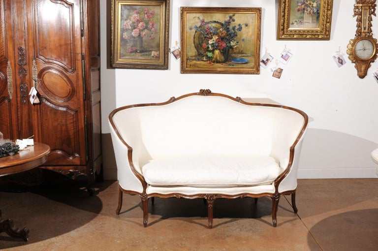Carved French 18th Century Louis XV Period Walnut Canapé from Lyon with Wraparound Back For Sale