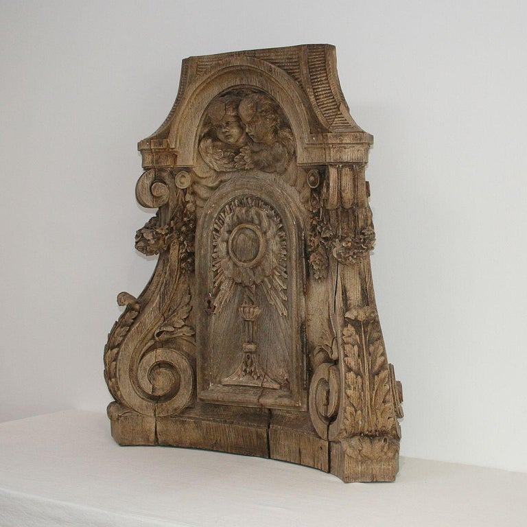Unique and truly beautiful weathered oak tabernacle front, France, circa 1750. Weathered, small losses and old repairs. This piece can stand on itself.