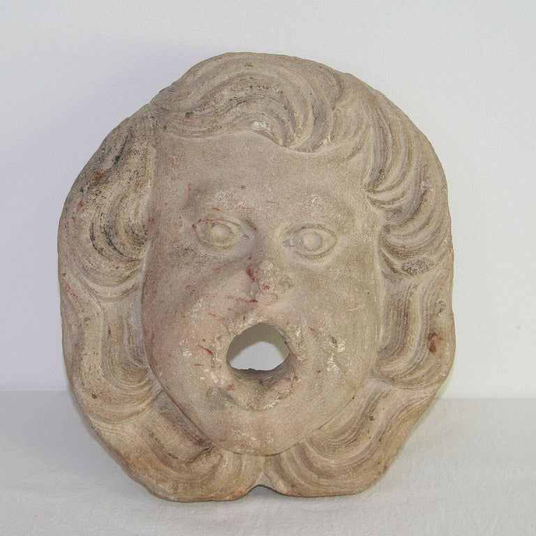 Beautiful carved stone fountain head with a great expression, France, circa 1750. Weathered.