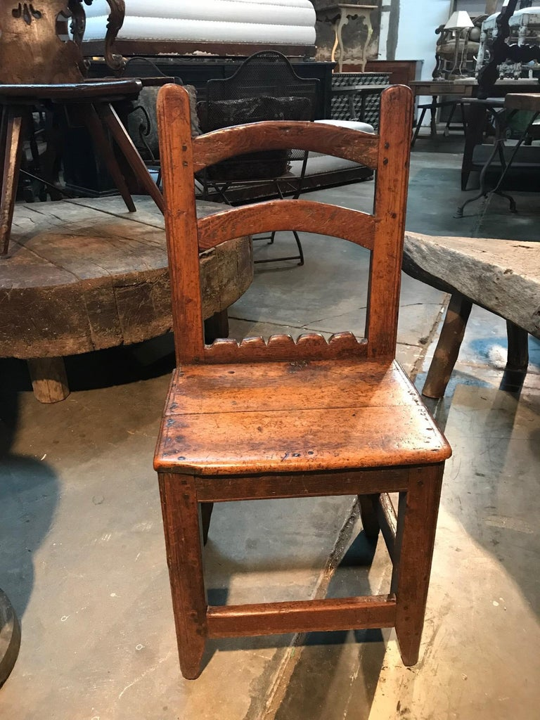 An absolutely charming 18th century diminutive side chair from Queyras - in the French Hautes Alpes. Wonderfully constructed from richly stained pine. Terrific patina - deep and luminous. The initials