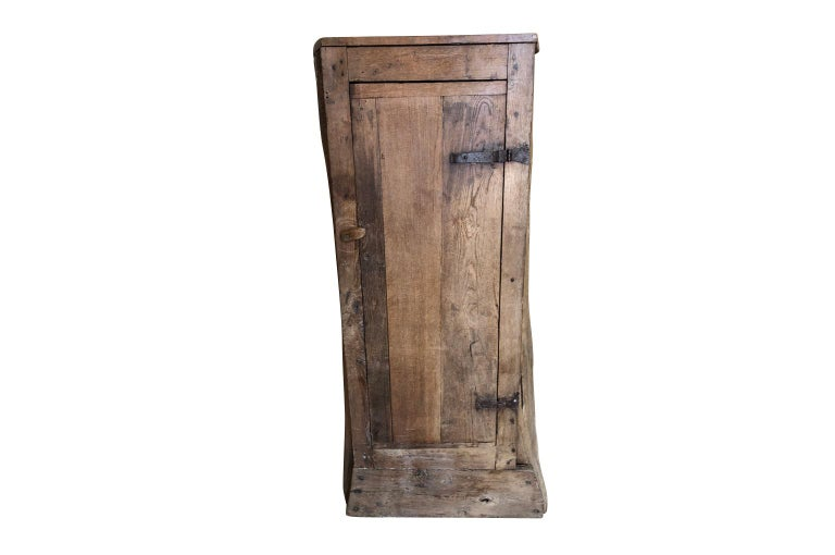 A very charming - Arte Populaire - Folk Art - 18th century French cabinet made from a hollowed out chestnut tree. The interior has shelves and ample storage space. A delightful hand crafted piece perfect for any casual living space.