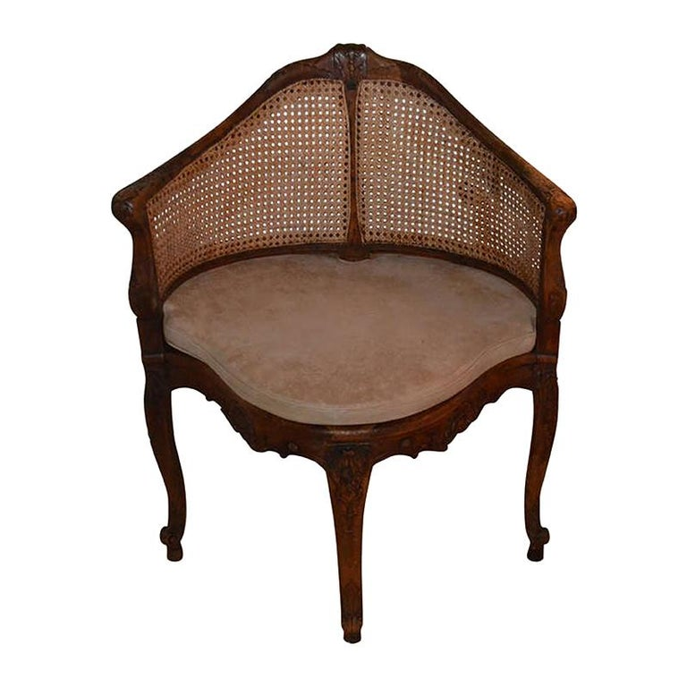 French 18th Century Walnut Corner Cane Chair For Sale