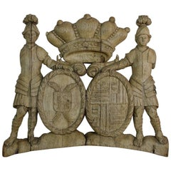 French 18th Century Weathered Oak Coat of Arms with Two Guardians
