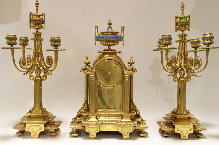 Very fine quality French 19th century Louis XVI style bronze and champlevé enamel clock set. Consisting of a clock and a pair of matching candelabras.