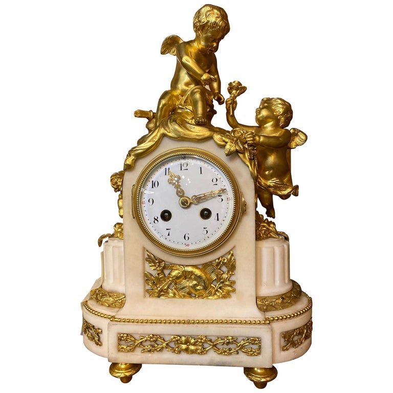 French 19th Century Ormolu White Marble Mantel Clock For Sale