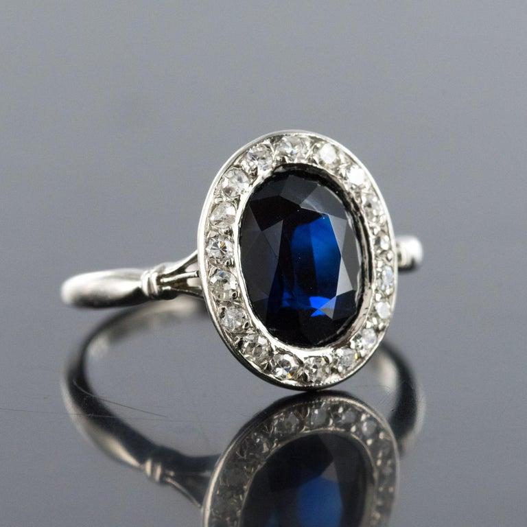 Women's French 1925 Art Deco Sapphire Diamonds Platinum Oval Cluster Ring For Sale
