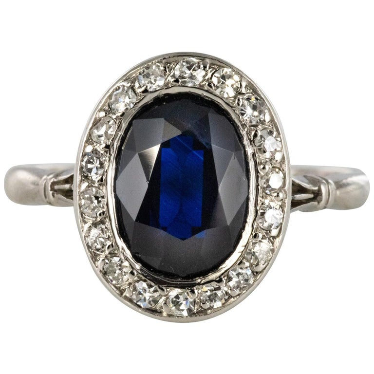 French 1925 Art Deco Sapphire Diamonds Platinum Oval Cluster Ring For Sale