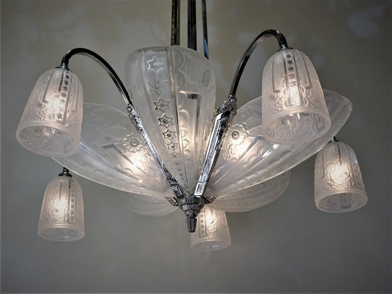 Ten geometric design clear frost glass with nickel on bronze frame Art Deco chandelier.