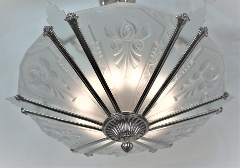 Twelve panel art deco chandelier, beautiful six clear frost molded and six clear frost with nickel on bronze frame. 