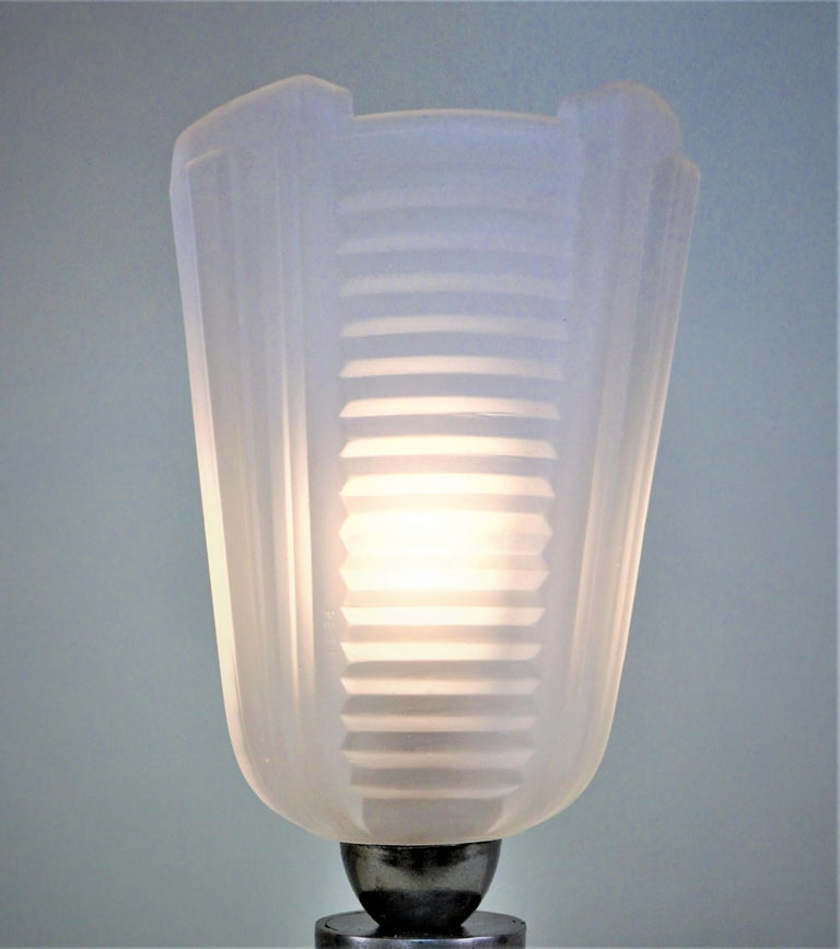 Handcrafted iron base with modern design clear frost glass shade by Petitot.