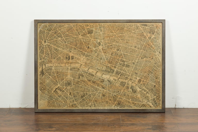 A French map of Paris from the early 20th century, with custom iron frame. Created in Paris during the second quarter of the 20th century, this map of Paris à vol d'oiseau (as the Crow flies) features the City of Lights as it was pre 1950s. The