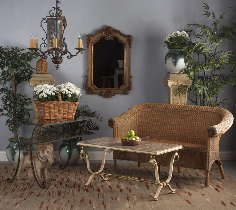 A vintage wicker sofa from France, circa 1930. Two-toned wicker with a pine and bamboo frame. The gentle curve of the back makes it a comfortable sit, loveseat sized and suitable for two adults. Curled lip design along the top with gracefully