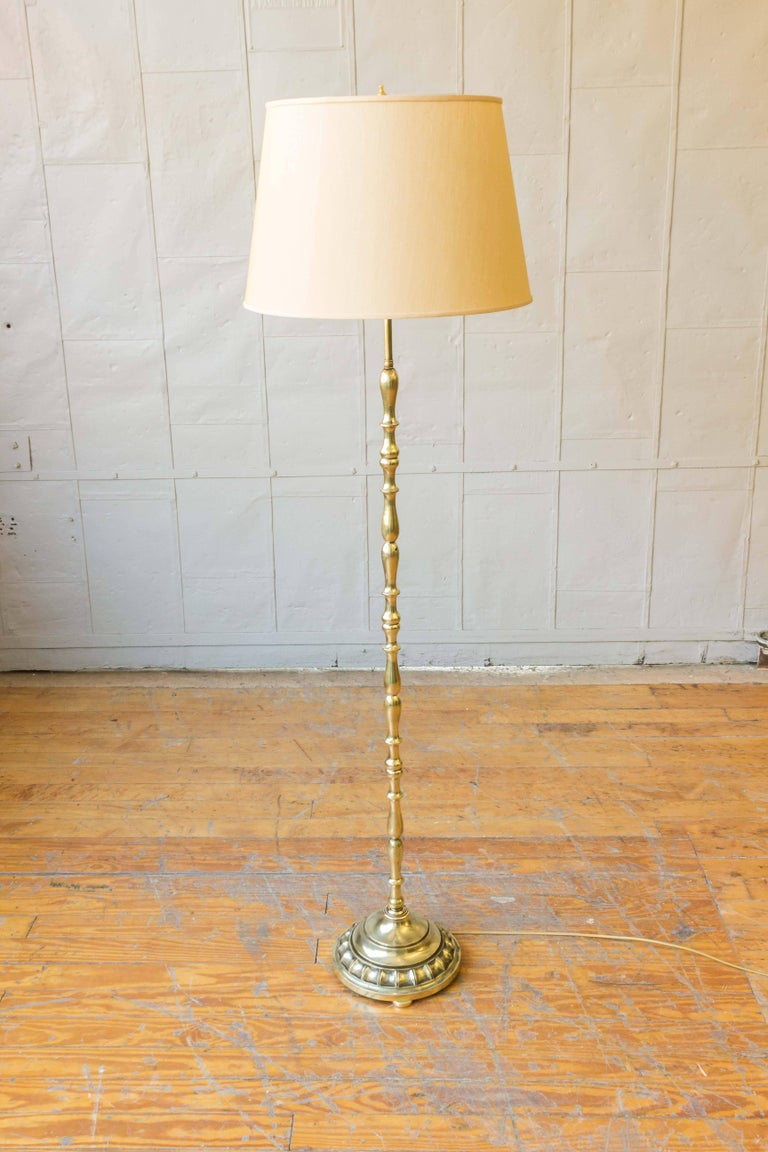 French 1940s brass floor lamp with turned stem and heavy base. Not sold with shade.