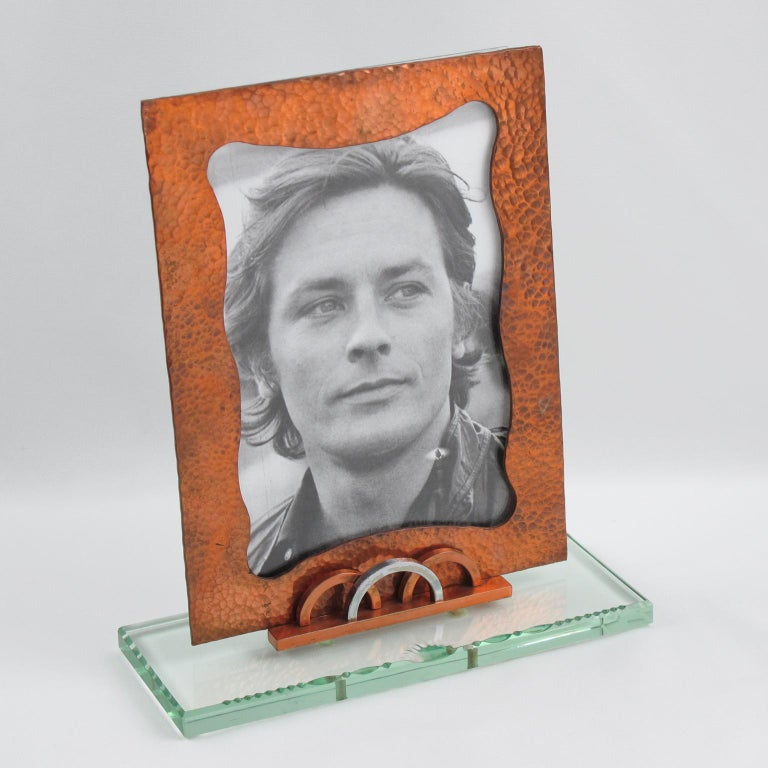 Stunning French geometric picture photo frame. Thick glass slab base with etching and garland beveling topped with copper and chrome geometric holder. The picture is held in a stunning copper frame with a hand-hammered finish. Two glass sheets