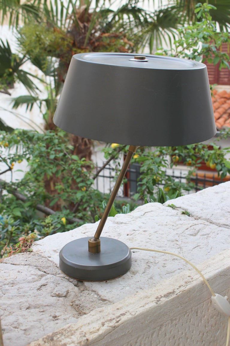 1950s desk lamp, grey military color adjustable shade and base as shown on the photos. Brass base and metal grey painted shade.