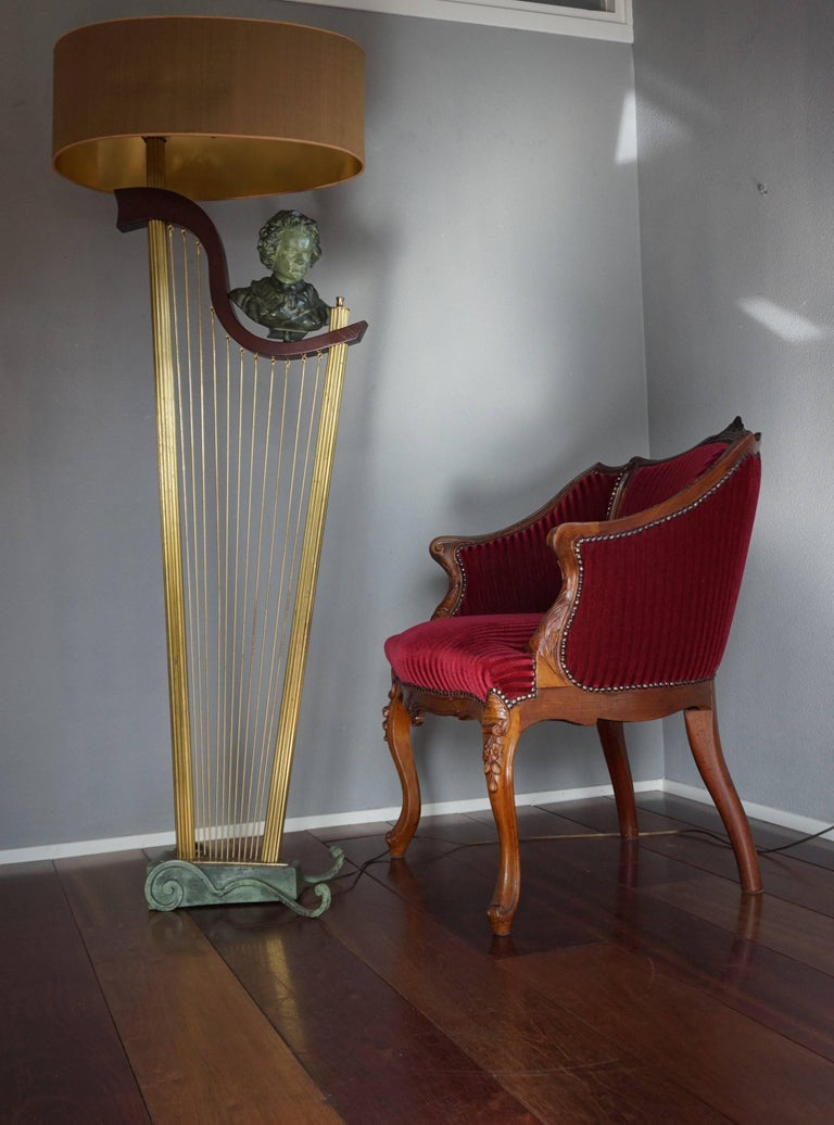 Classical music inspired sculptural floor lamp.  This very rare and sculptural floor lamp could be the perfect lighting solution for anyone who loves both the Art Deco style period and classical music. The artist who designed this harp floor lamp