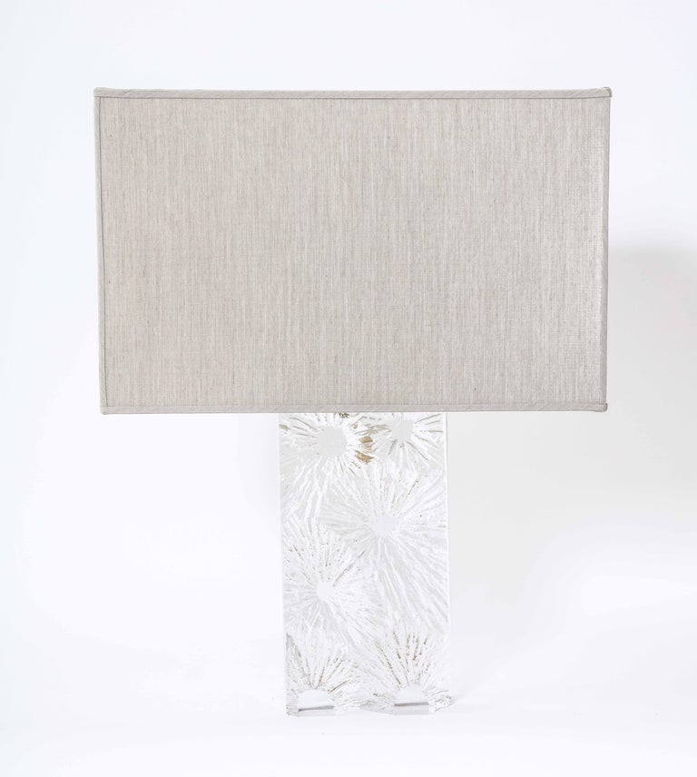Crystal table lamp by Daum with acid engraved Chardon motif, signed on the bottom.