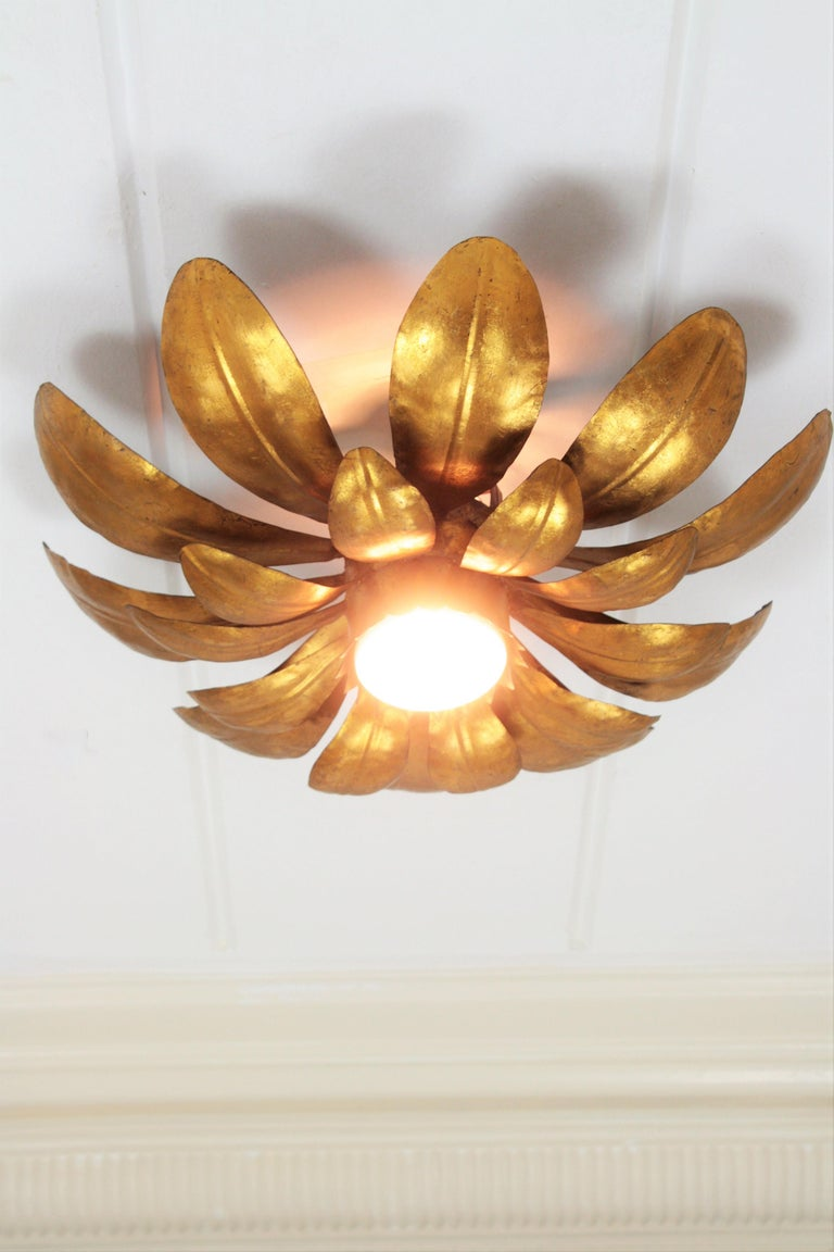 Gold Leaf French, 1950s Gilt Iron Flower Shaped Sunburst Ceiling Flush Mount Light Fixture For Sale
