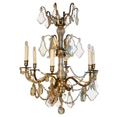 French 1950s Metal and Crystal Chandelier with Six Outer and Six Inner Lights