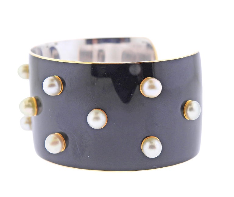 Mid century French made cuff bracelet in 18k white gold, decorated with black lacquer enamel and 5mm pearls. Bracelet will comfortably fit an average wrist 6.75