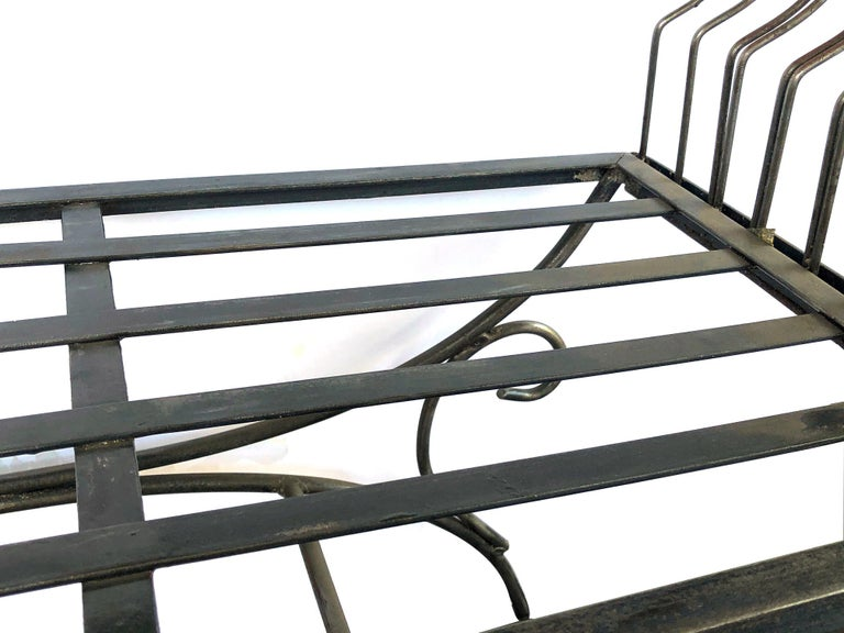 Hand-Crafted French 1950s Raw Iron Curule-Form Bench with Incurved Arms For Sale