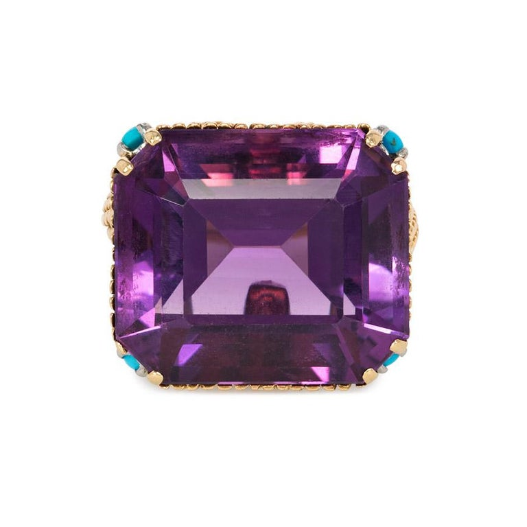 An amethyst cocktail ring in a woven ropetwist gold mounting with turquoise and diamond embellishment, in 18k.  France  Top measures approximately 2mm x 2mm Current size: US 7 (Please contact us with any sizing questions.)