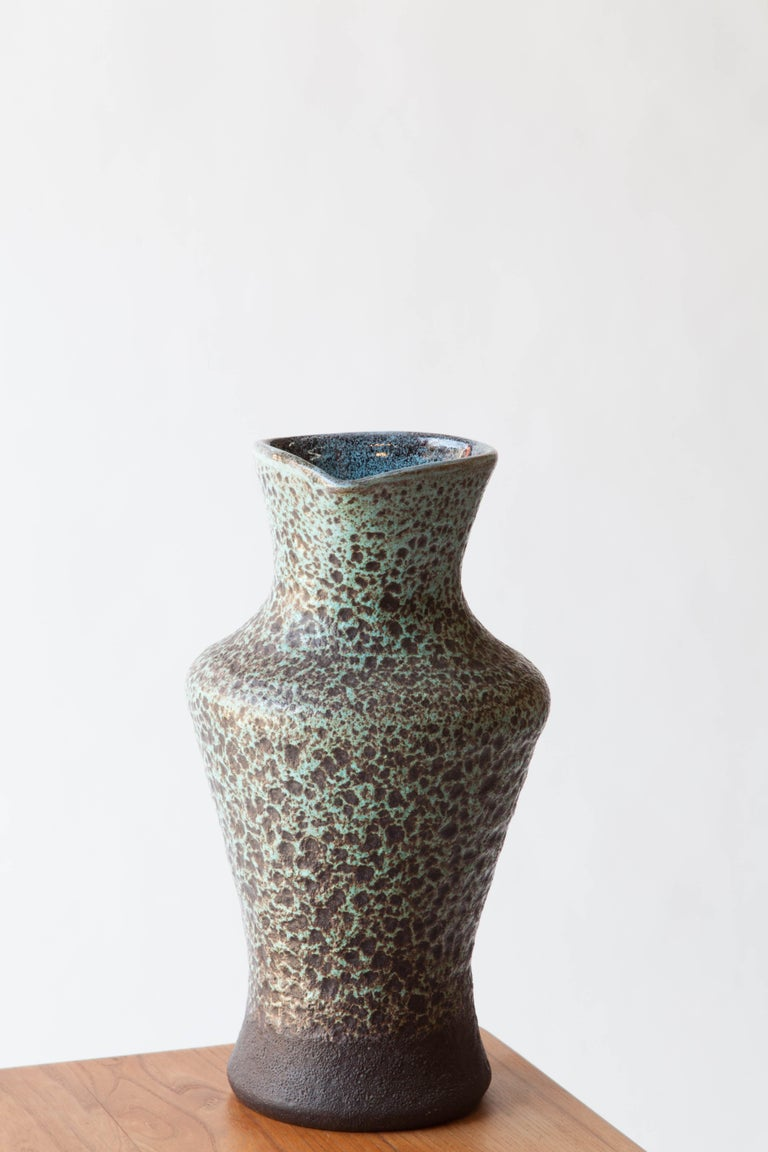 A satin glaze on an organic formed ceramic pitcher. Accolay, France. 1960s. From the